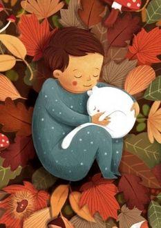 Фото Ребенок спит с белым котенком на осенних листья