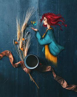 Фото Над рукой девушки птичка, чашка кофе и колоски на синем фоне, by cuordicarciofo