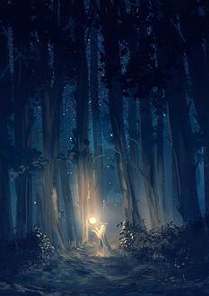 Фото Девушка с огненным шаром над руками стоит в лесу