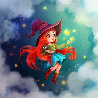 Фото Девочка в шляпе ведьмы с кошкой в руках в окружении облаков
