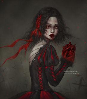 Фото Темноволосая девушка держит в руках сердце, by NanFe