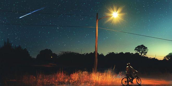 Фото Мужчина на велосипеде, стоя под фонарем, смотрит на падающую звезду, art by Kirk Quilaquil