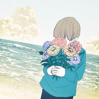 Фото Мальчик с букетом цветов на морском берегу