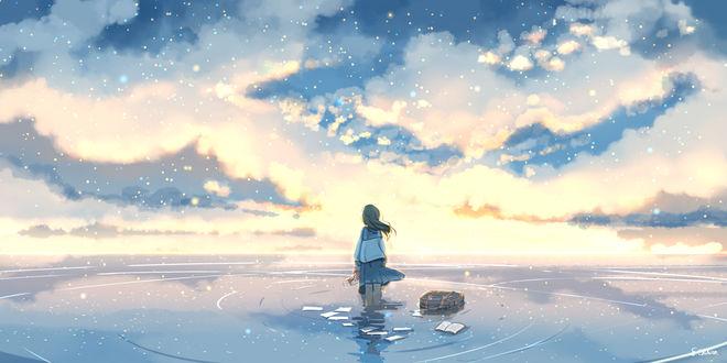 Фото Школьница стоит в воде на фоне закатного неба
