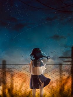 Фото Школьница смотрит на падающую звезду, стоя у железного забора