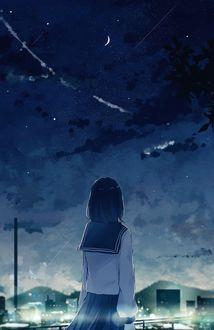 Фото Школьница смотрит на ночной город