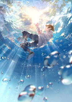 Фото Парень в лучах солнца под водой