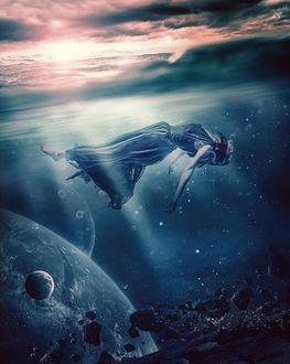 Фото Девушка парит над водой
