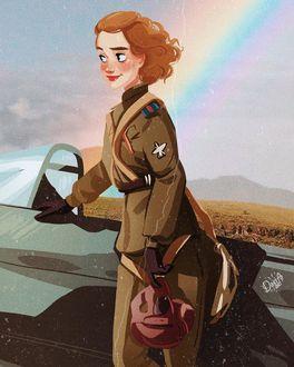 Фото Девушка-пилот со шлемом в руке стоит у самолета
