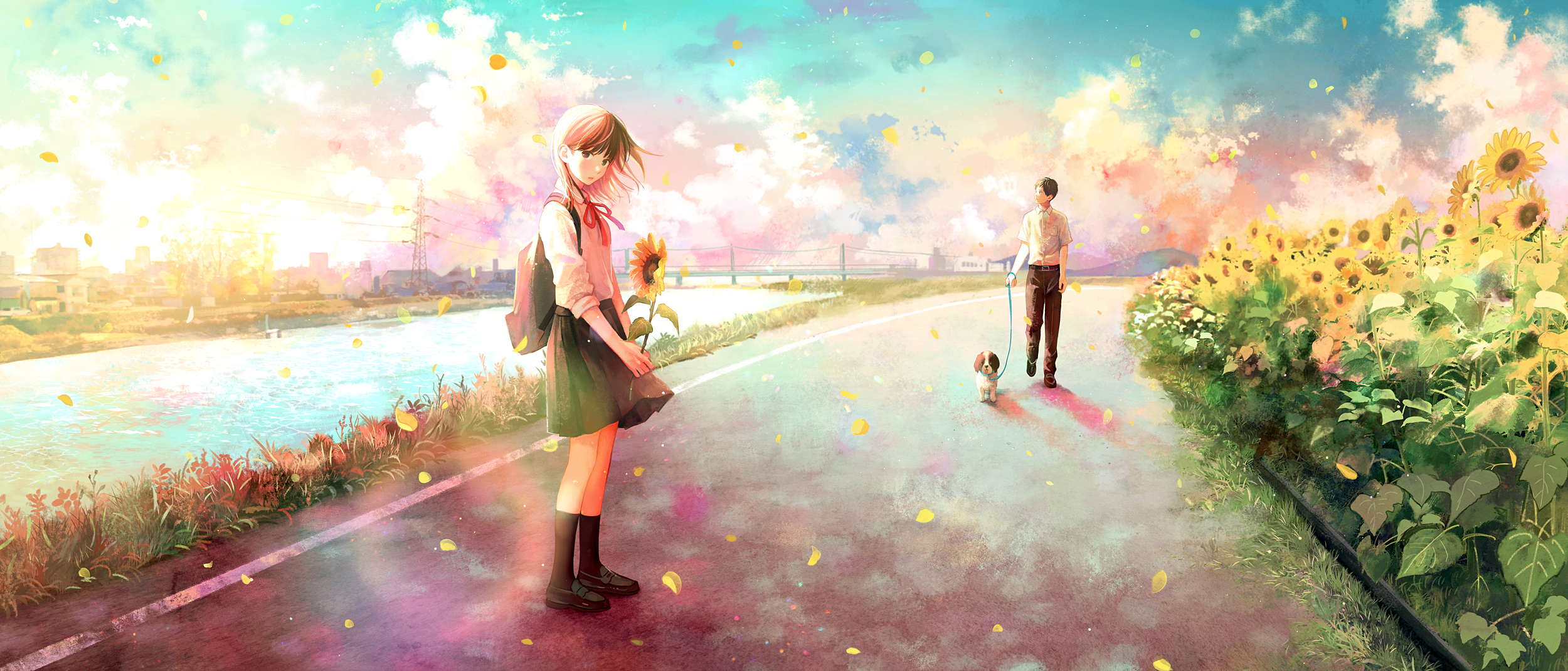 Фото Девочка с подсолнухом стоит на дороге, где поодаль стоит парень с собакой