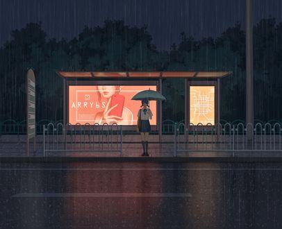 Фото Девушка стоит на остановке, прячась под зонтом от дождя