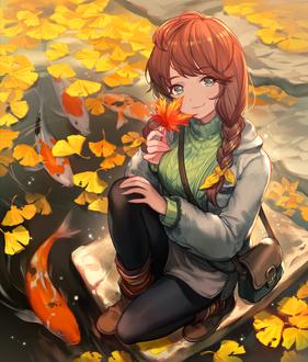 Фото Девочка с осенним листиком и сумочкой на плече сидит в окружении осенних листьев и карпов в воде