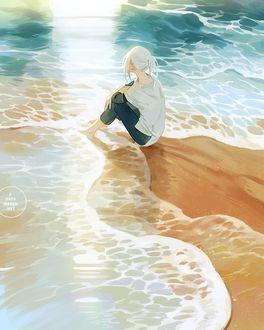 Фото Девушка сидит у моря