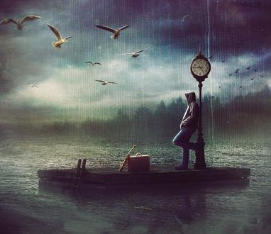 Фото Парень стоит у городских часов перед вещами-чемоданом и зонтом, в окружении воды, под дождем, by caddman
