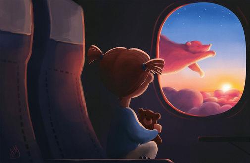 Фото Девочка смотрит в иллюминатор, за которым видит медведя над облаками
