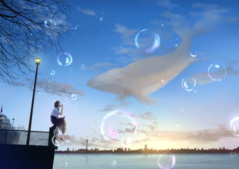 Фото Девушка сидит на заборе и пускает мыльные пузыри