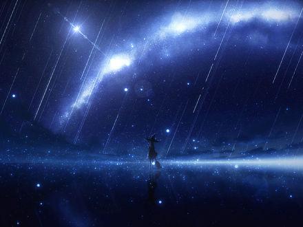Ведьма стоит на зеркальной поверхности под звездным дождем
