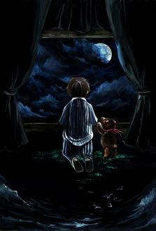 Фото Мальчик и плюшевый мишка смотрят в окно на ночное небо