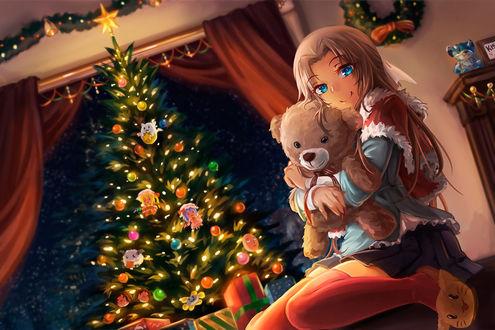 Фото Девочка сидит в обнимку с плюшевым мишкой