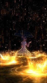 Фото Девушка с зонтом стоит под дождем в сияющей воде