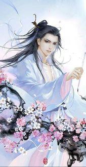 Фото Длинноволосый парень в китайской одежде с кистью