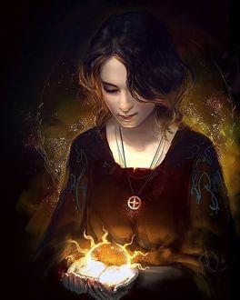 Фото Девушка наклонив голову смотрит на светящуюся магию в руках, by anndr