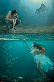 Фото Девушка под водой с протянутой рукой вверх, на берегу сидит парень и смотрит на нее, by Ahmed Shammari