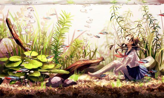 Фото Школьница сидит на дне аквариума