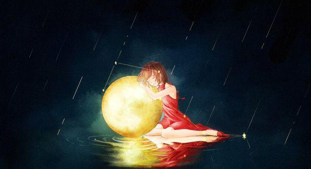 Фото Девочка с луной сидит под дождем в воде