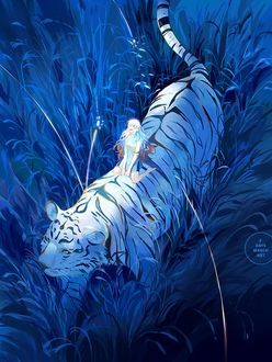 Фото Девочка на тигре в траве