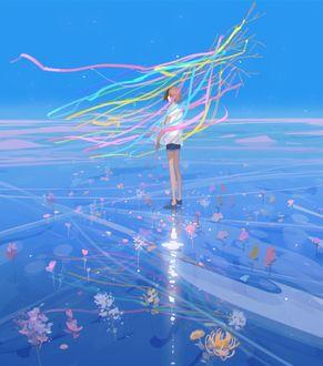 Фото Девочка стоит на льду в цветных лентах