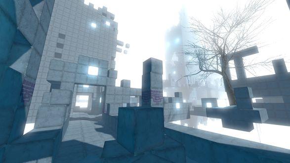 Фото Огромное строение из кубов-монолитов с белыми светильниками, встроенными в стены, с цветущим неподалеку единственным деревом, на фоне белого зимнего неба