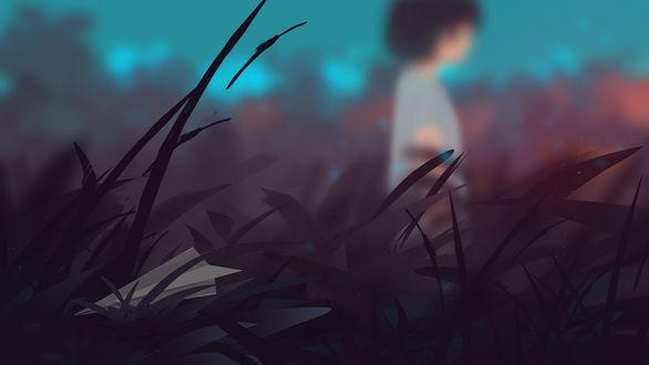 Фото Размытый силуэт ребенка и бумажный самолетик, застрявший в траве