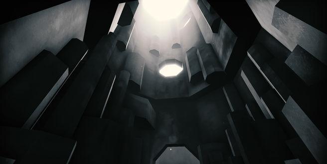 Фото Большое восьмигранное помещение, в стены которого были встроены отдельные восьмигранные блоки-столбы, изображенное на черно-белом фоне, освещаемая сверху белым светом / Из игры EGO