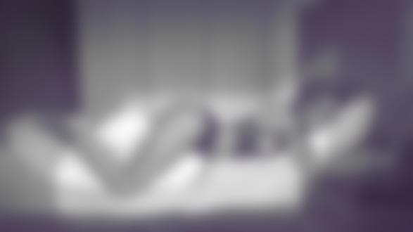 Фото Девушка в нижнем белье с телефоном в руке лежит на постели, by Krystopher Decker