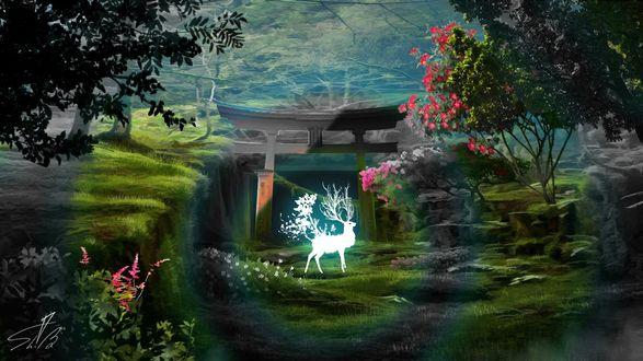 Фото Сказочный олень стоит на зеленой траве