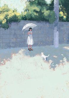 Фото Девушка с зонтом стоит перед кошкой