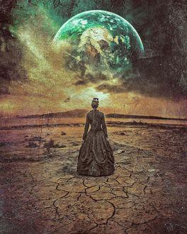 Фото Девушка в длинном черном платье стоит на фоне неба с планетой, by Peter Brownz Braunschmid