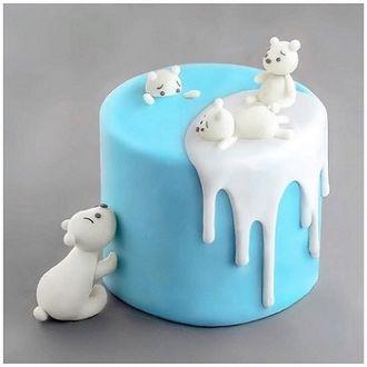 Фото Оригинальный торт в виде белых мишек лежащих на льдине и купающихся в море