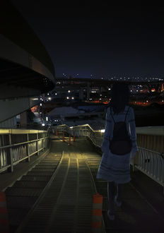 Фото Девушка с рюкзаком за спиной спускается вниз по дороге