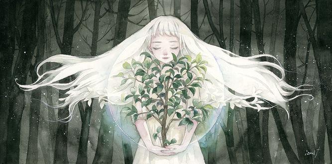 Фото Белокурая девушка с саженцем в руках на фоне голых деревьев
