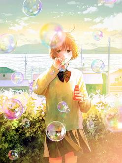 Фото Школьница пускает мыльные пузыри