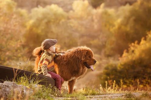 Фото Мальчик сидит рядом с собакой. Фотограф Марина Бережная