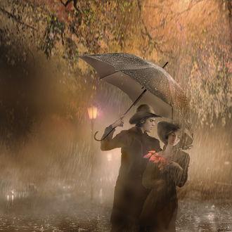 Фото Парень с зонтом прикрывает девушку от дождя. Фотохудожник Igor Zenin