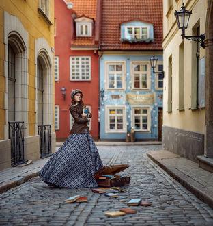 Фото Девушка с книгами в руках стоит на улице города, by Irina Dzhul