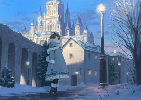 Фото Девочка стоит на дорожке заснеженного города