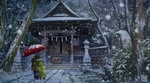 Фото Дети стоят под зонтом под падающим снегом перед домом