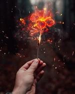 Фото Горящая спичка с пламенем в виде цветка в руке, by Farzana Ria