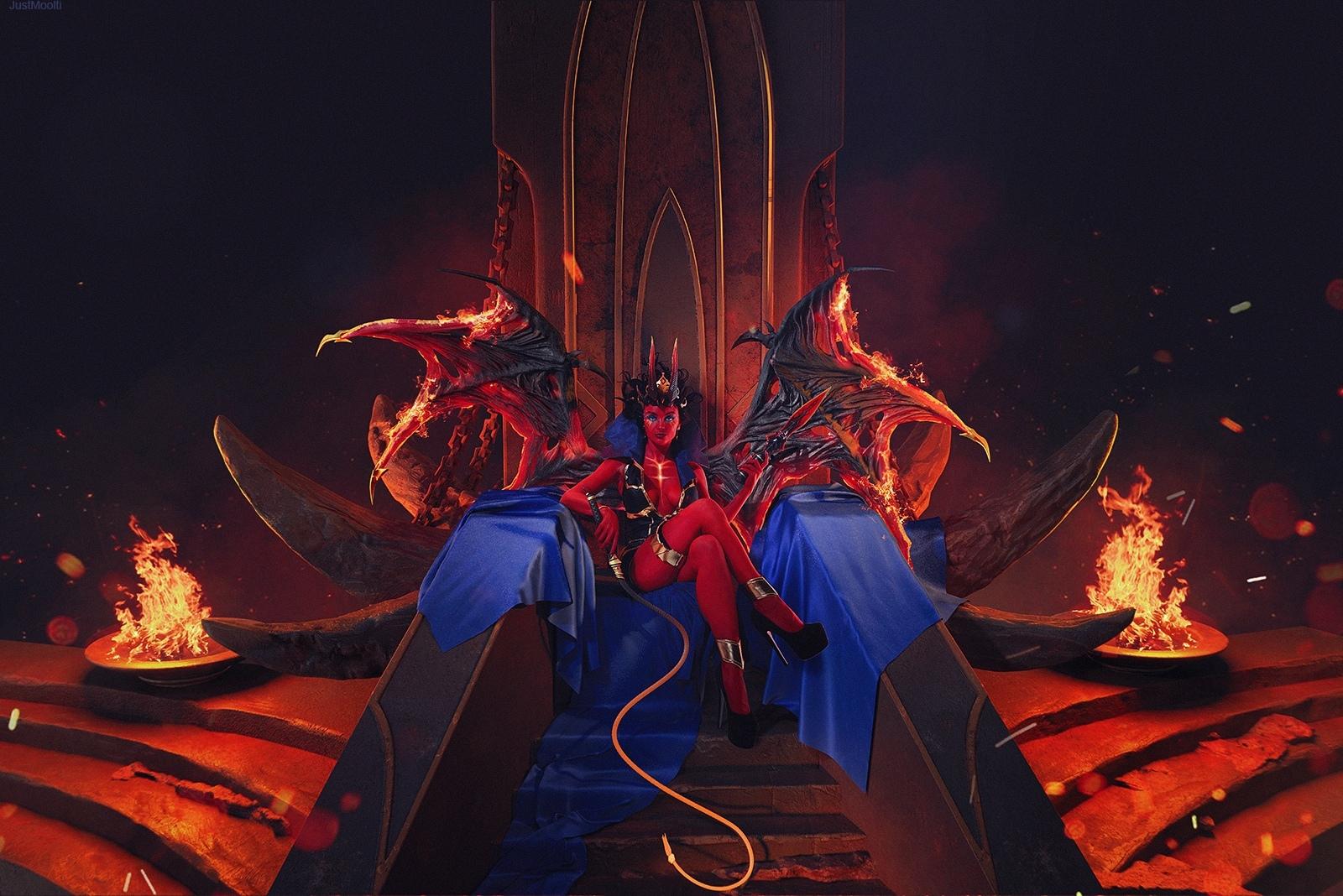 Фото Девушка в костюме демона сидит на синей ткани на троне среди огня
