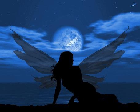 Анимация Девушка с крыльями бабочки сидит на морском берегу и у нее над головой периодически появляется светящийся контур сердца